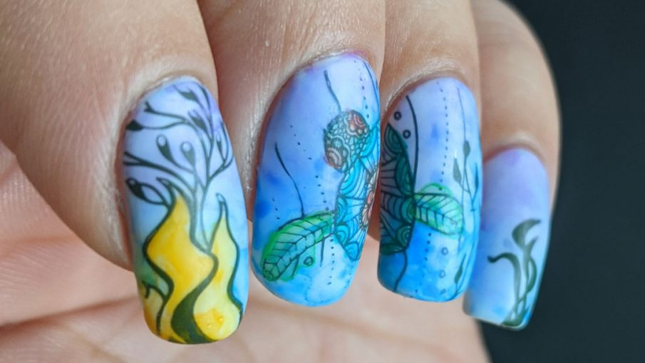 A watercolor nail art with a sea turtle with mandala-esque patterns and lots of kelp colored in with actual watercolor paint.