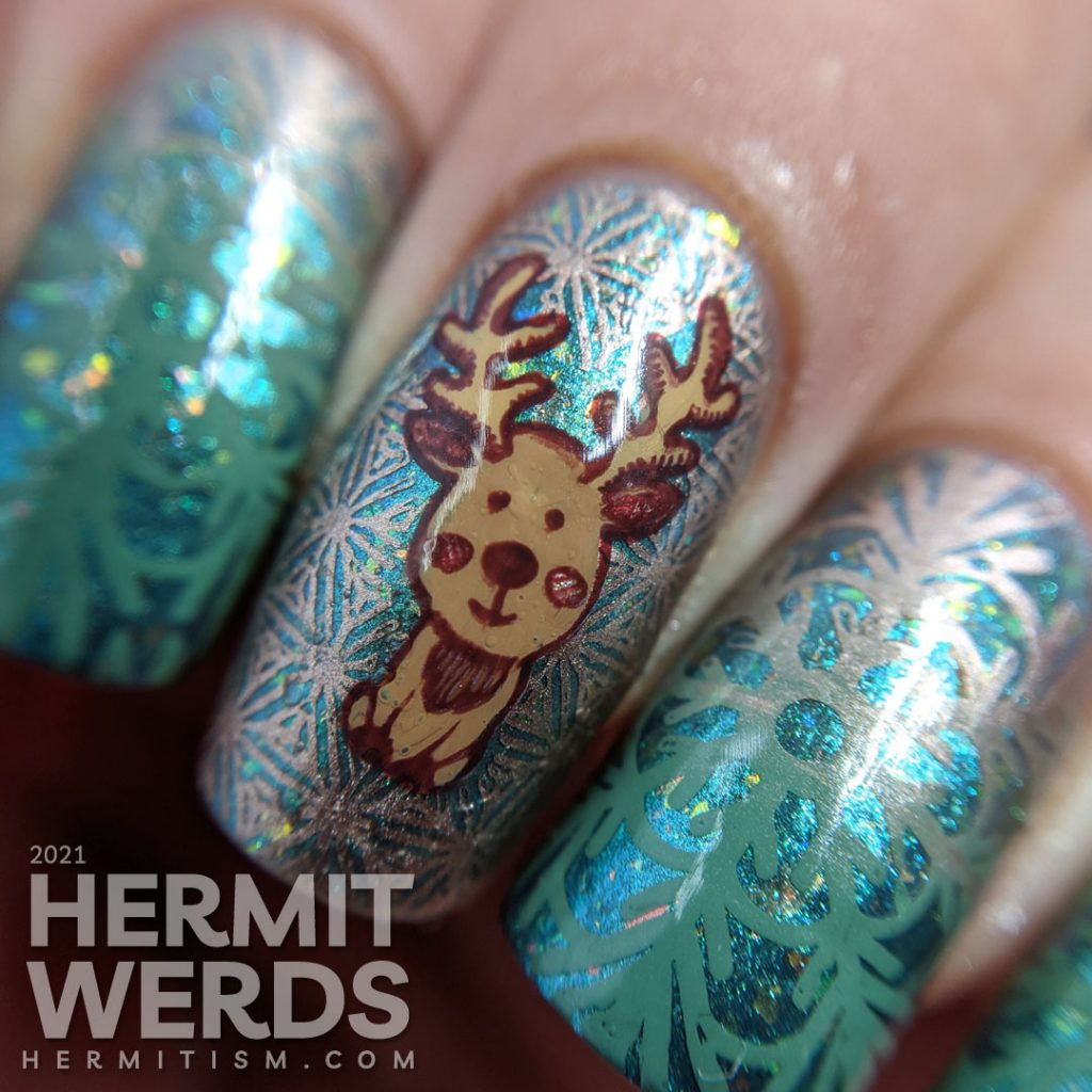 An aqua magnetic baby boomer french tip nail design with green to rose gold gradient snowflakes and a cute reindeer stamping decal.