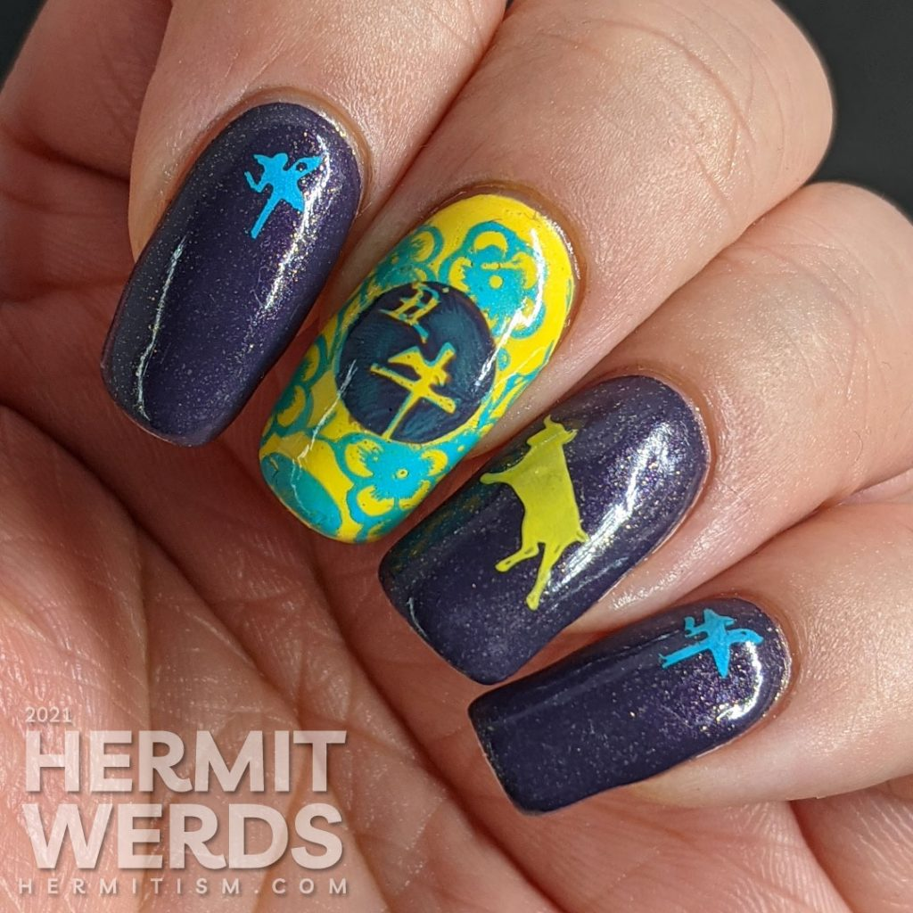 Chinese New Year Year of the Ox nail art in ox's lucky colors: purple, yellow, and blue.