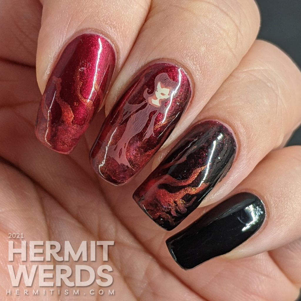 A red to black gradient nail art with swirls of magic and a wicked, sexy witch casting a summoning stamped on top plus a haunted house.