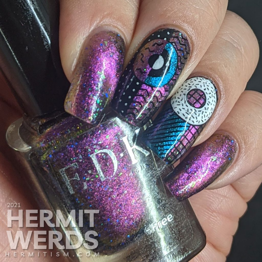 A gorgeous multichrome indie magnetic polish with abstract donut shapes and very 80s patterns stamped on top.