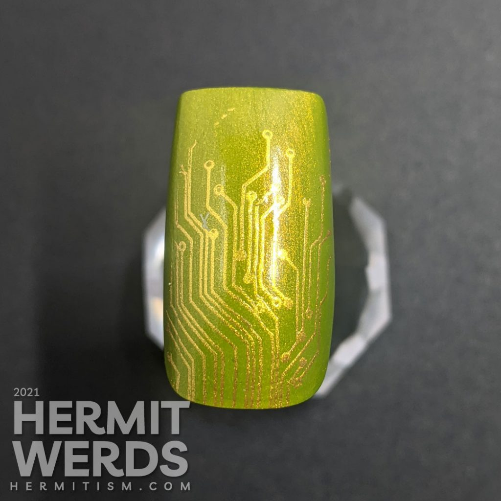Step 1, The green/gold base is painted and a brassy gold circuit board pattern is stamped on top.