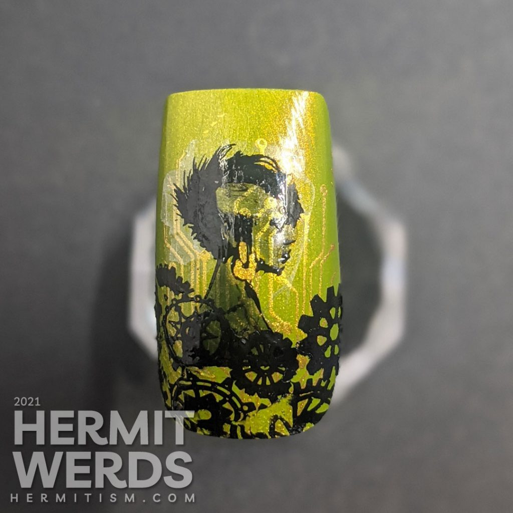 Step 3, a bunch of black gears are stamped at the bottom of the nail, covering the end of the lady's stamping decal.