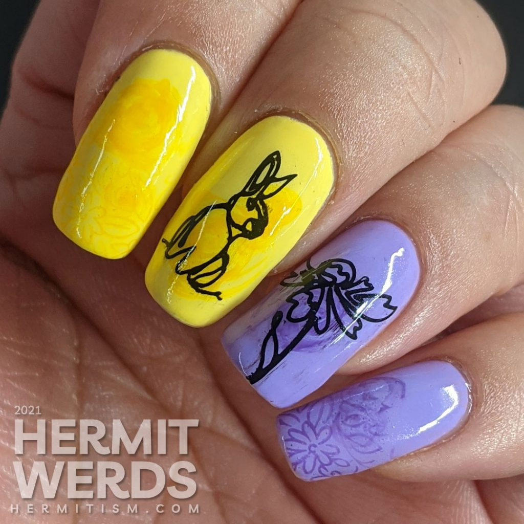 Light purple and yellow nail art with swirls of darker polish highlighting freeline spring images of a bunny and flowers.