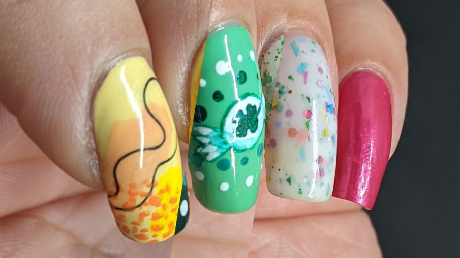 Three sweet nail art looks: yellow and orange heart balloons, green clover candies, and sweet blue and pink lollipops.