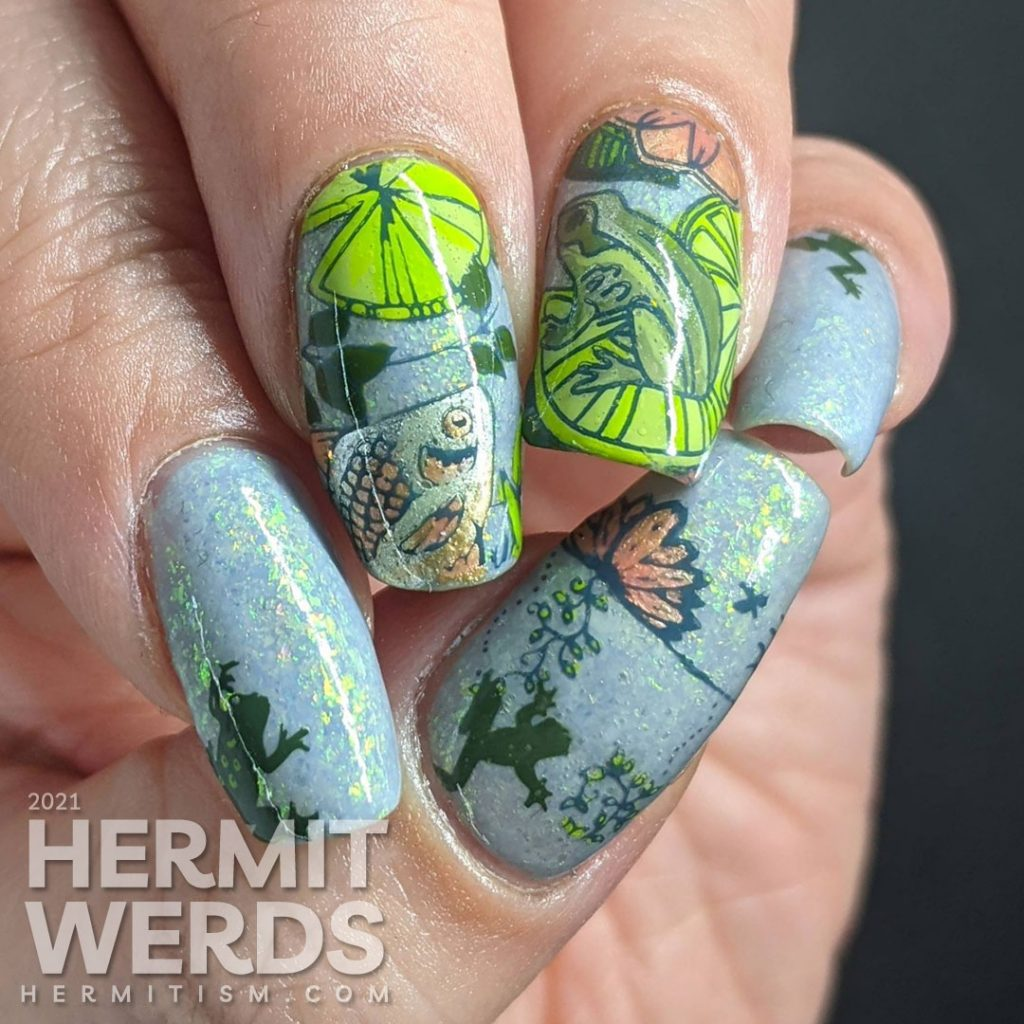 A soft blue-green mani of pond life, mostly frogs and one fish stamping decal with lily pads and other pond greenery.