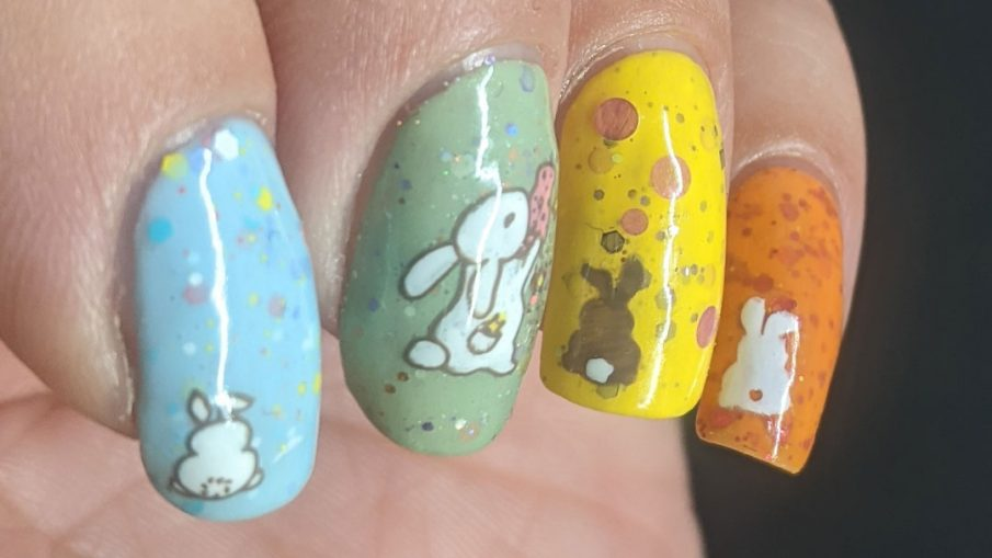 A pastel Easter crelly skittle nail design with a magical bunny, cute bunny butts, and a bunny in a jar for next year.