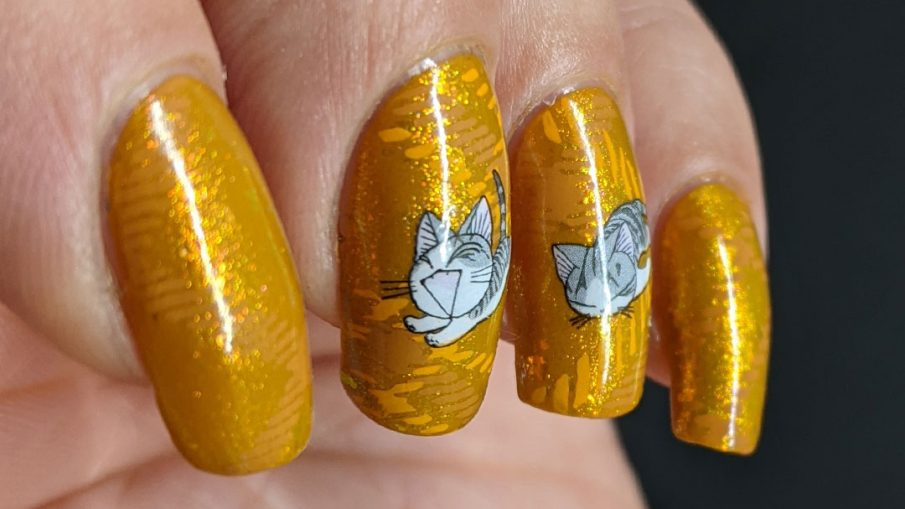 A super mustard-y nail art with a stamped plaid background pattern and cute grey cat water decals sleeping, playing, and talking to you.