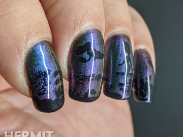 An ultra multichrome base polish from turquoise to purple to orange with ocean floor and swimming mermaids stamped on in black.