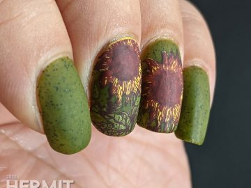 Autumn-esque nail art of yellow, orange, and brown sunflower stamping decals on an olive green speckled nail polish base.