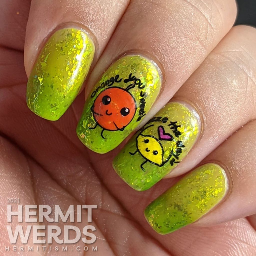 A yellow to bright green thermal polish with sweetly flattering orange and lemon stamping decals on top and more happy food on the thumb.