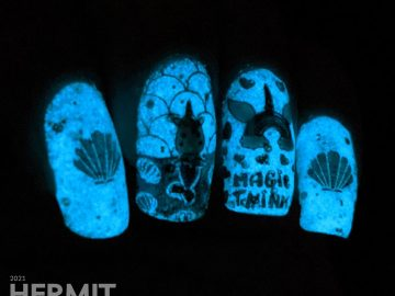 Teal glow in the dark nail art with a mermaid unicorn (mermicorn) stamping decal and a narwhale.