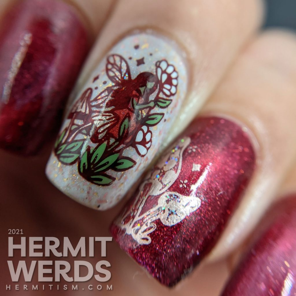 A red magnetic nail art with soft rose gold crelly accent nails and stamping decals of fairies, mushrooms, and flora.