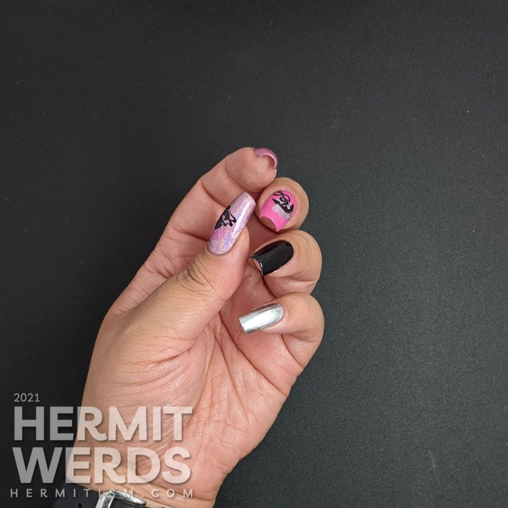 Nautical nail art in pink, black, and silver with lots of anchor stamping decals and a kiss of holographic nail polish.