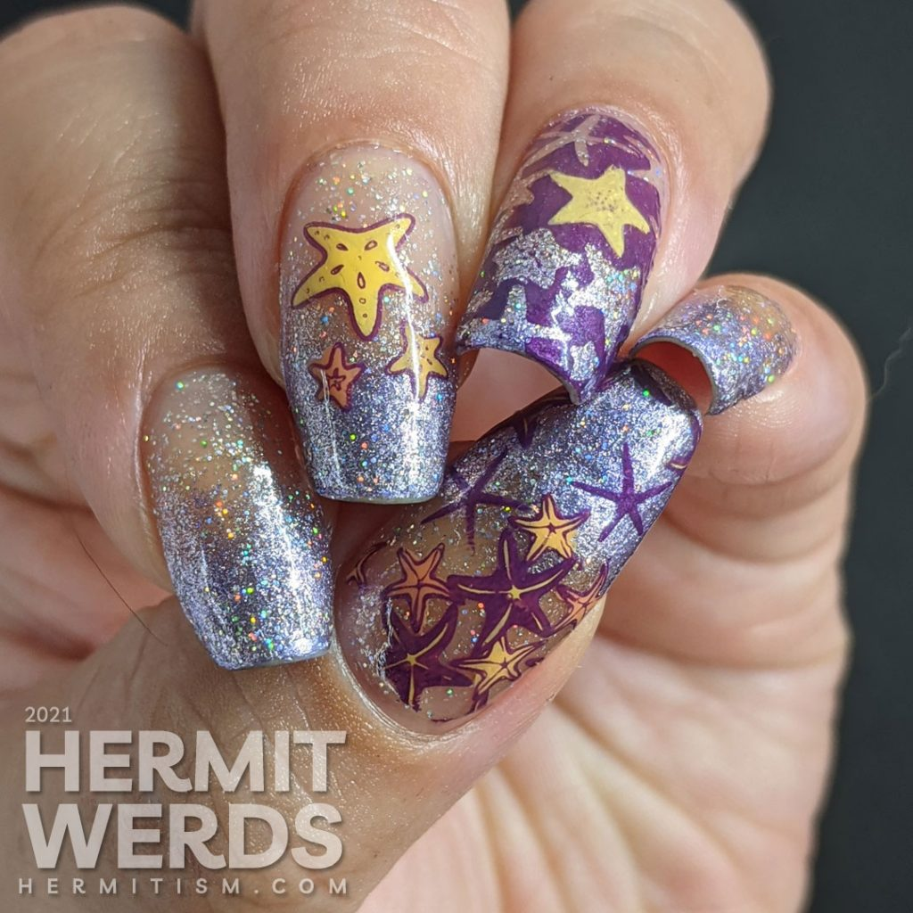 A purple baby boomer French tip nail art with a solar holographic glitter polish and starfish stamping decals on top.