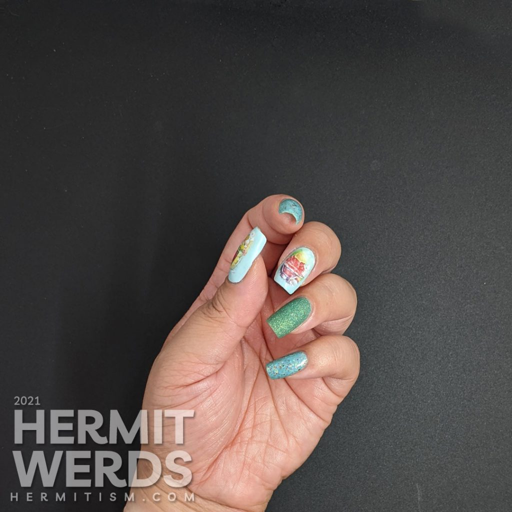 Teal/blue-green nail polishes with soft watercolor-like water decals of yummy ice cream dishes (sundae and milkshake) on top.
