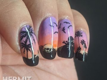 A sunset beach-themed nail art with nail stamps of palm trees, seagulls, and skeletons. The best of tropical nightmares.